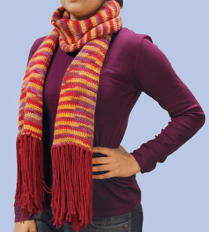 Lightweight autumn-colored, red, orange, yellow, brown, purples scarf with fringe.