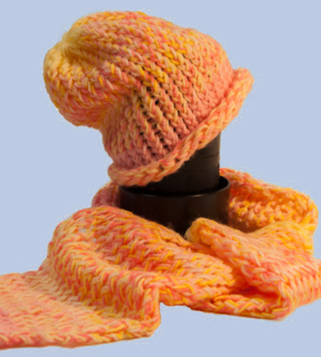 A pink, yellow, and orange scarf and hat made for babies.