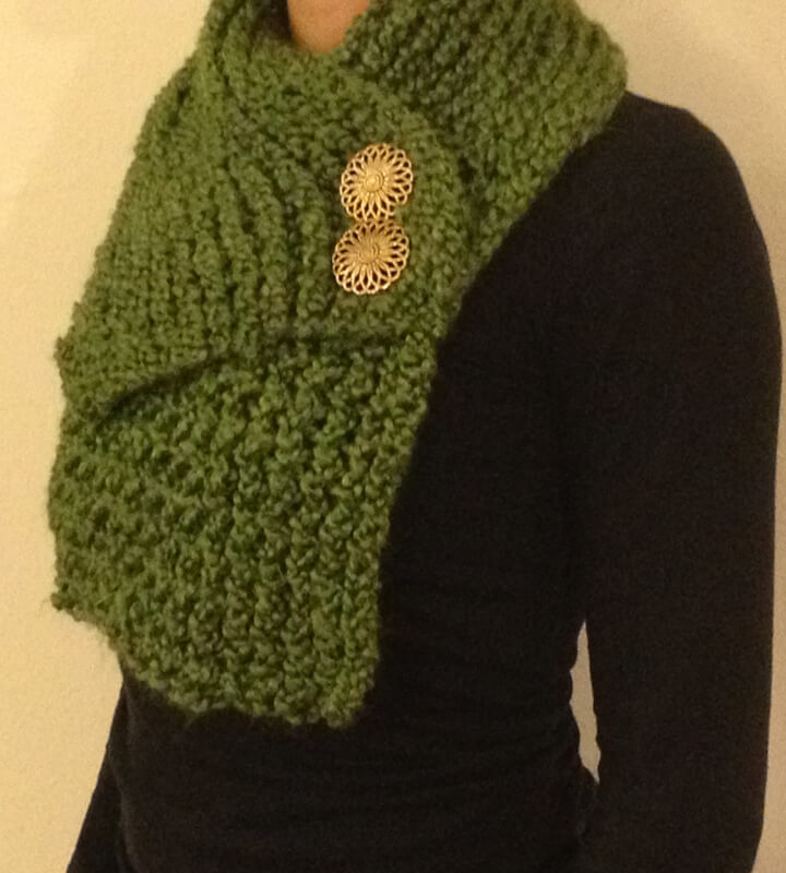 Green, lightweight scarf pullover with gold button detailing.
