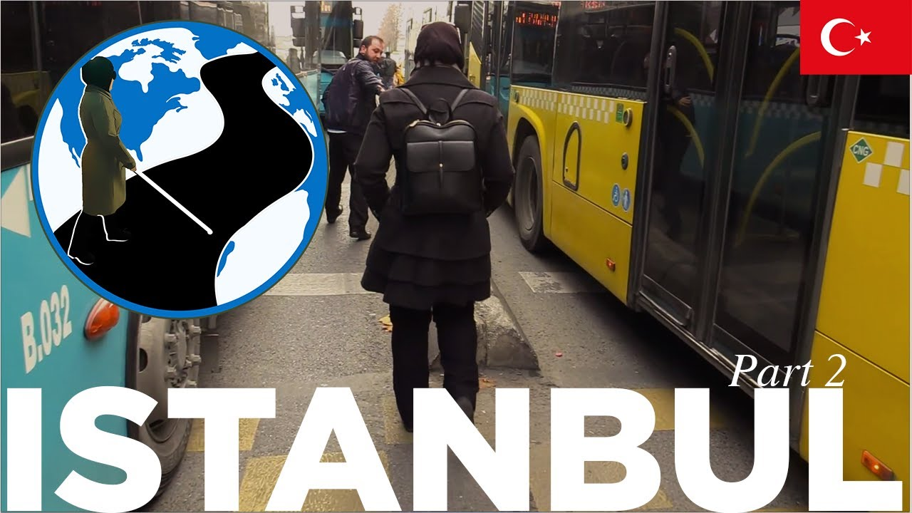 A thumbnail for Say the Name and Just Gesture! - Planes, Trains and Canes Istanbul Episode 3 Part 2. An image of Mona standing in a Turkish bus terminal. Superimposed on the image is the PTC Logo and a flag of Turkey.