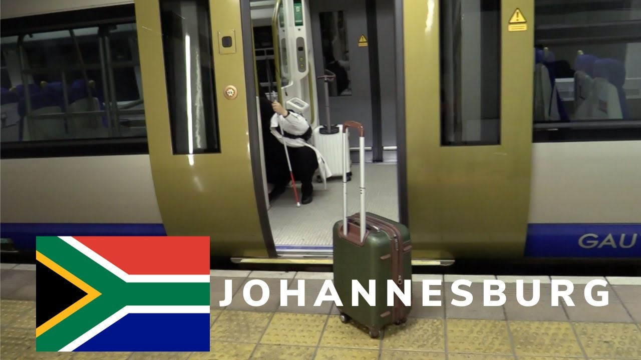 A thumbnail for The Power of Determination: Do I make it? Johannesburg Episode 1 Part 1. An image of Mona boarding a metro train in Johannesburg. Superimposed on the image is the South African Flag.